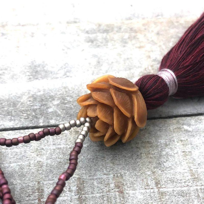 burgundy lotus necklace closeup