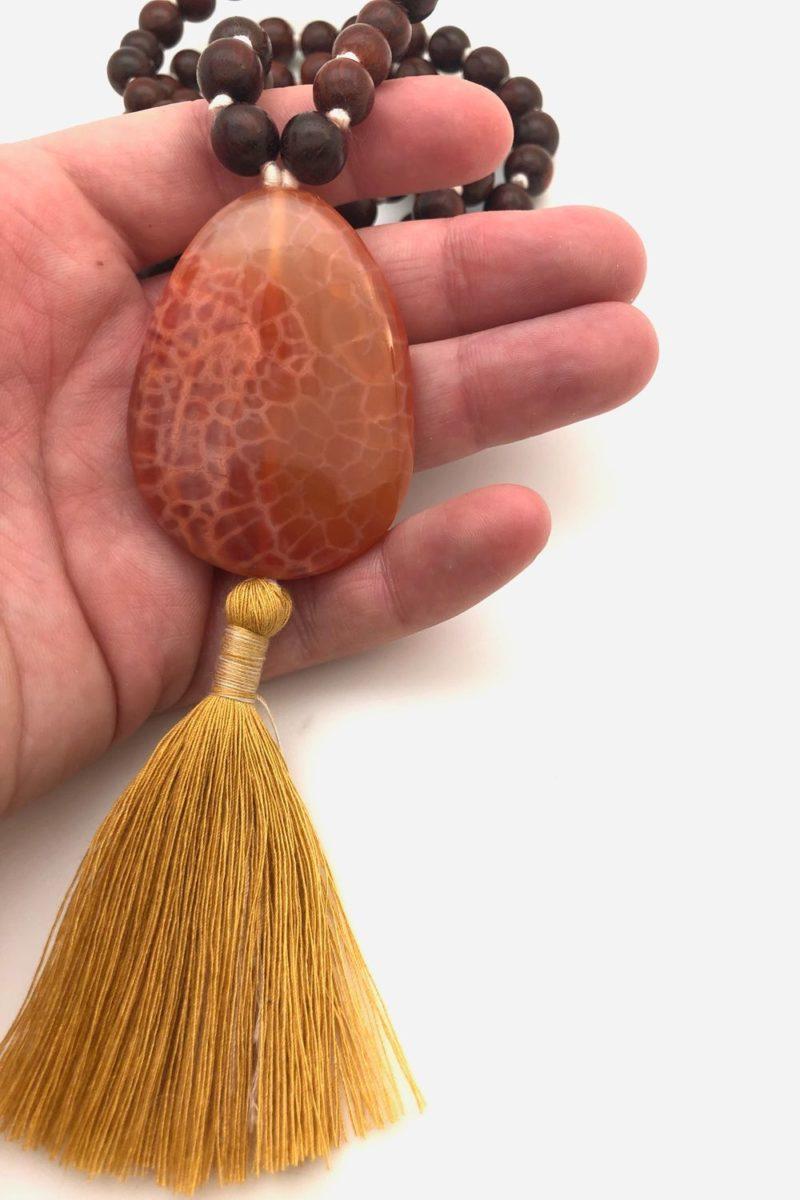 carnelian rosewood guru mala in hand