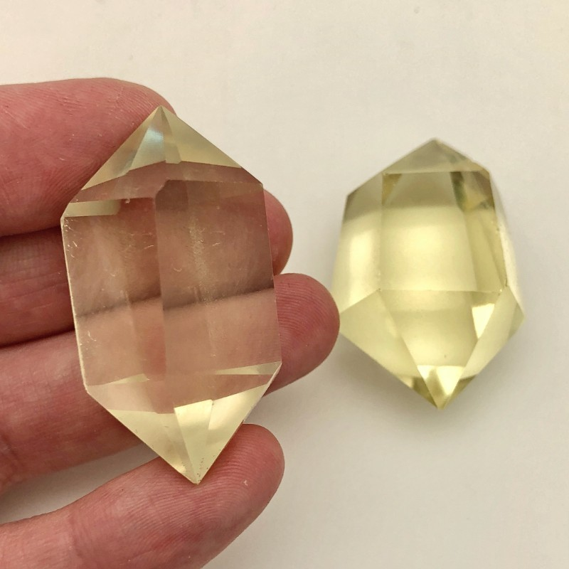 double citrine point in hand