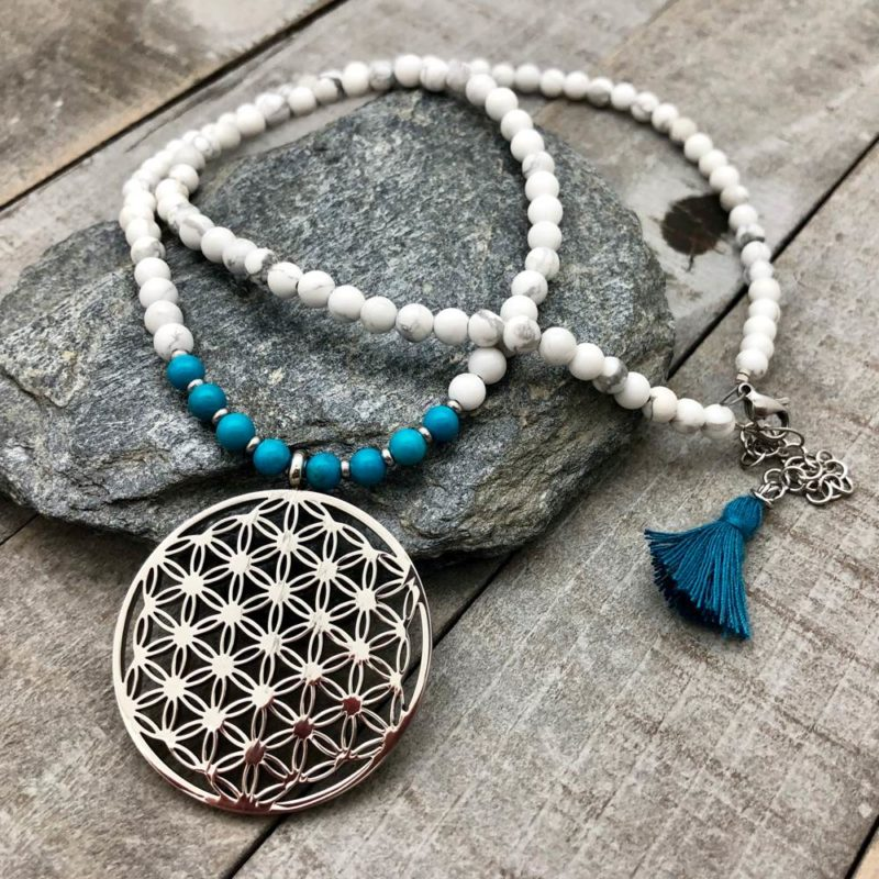flower of life necklace on rock