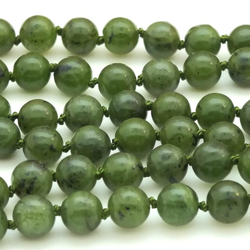 closeup of knotted jade beads