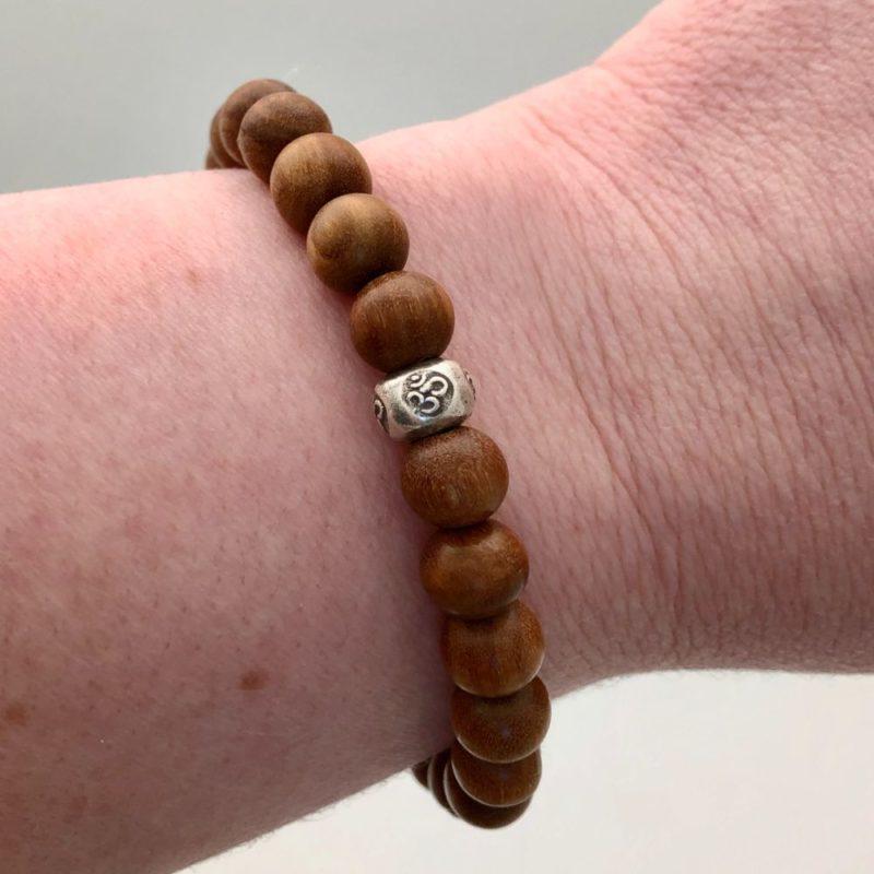 Sandalwood Om Bracelet - sandalwood om bracelet on wrist