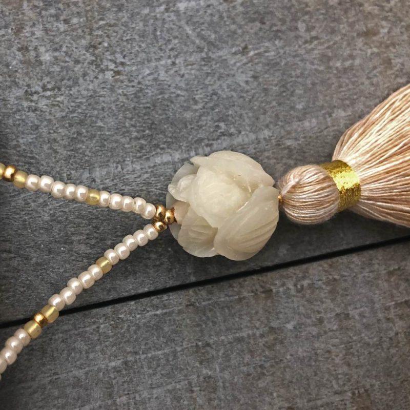 white lotus necklace closeup
